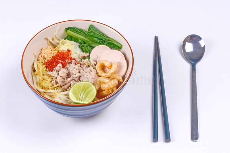 Two tone noodle ,white and yellow, with tom yum. Two tone noodle ,white and yellow, with tom yum topped minced pork ,chili ,minced nut ,boiled kale , sliced stock images