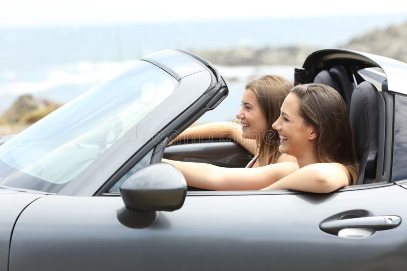 Two tourists driving a car on vacations royalty free stock photo