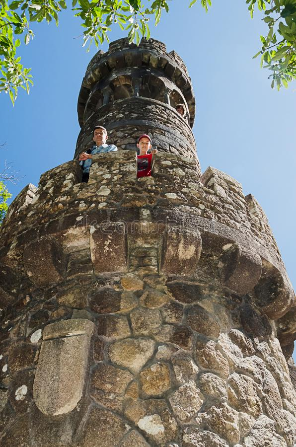 Two tourists, father and son, on old tower stock photos