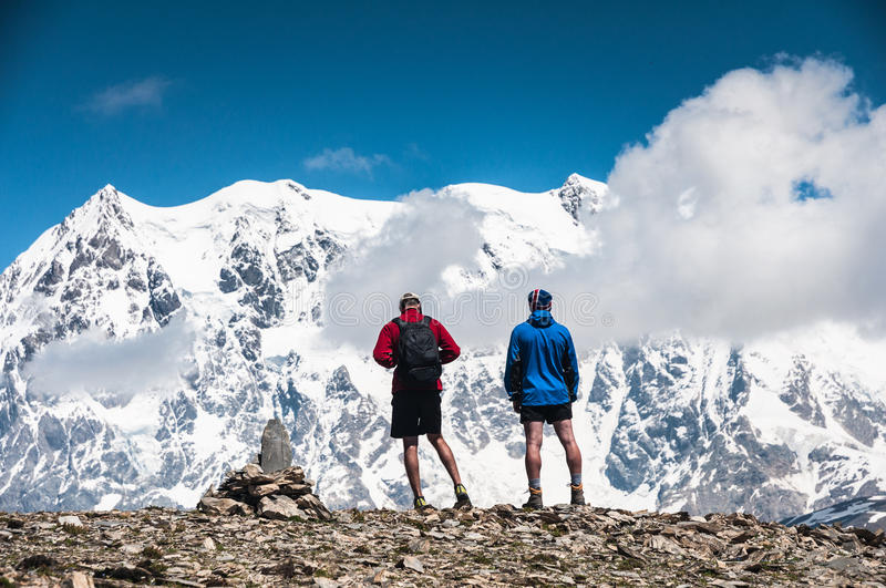 Two tourists on the top. Of the mountain royalty free stock images