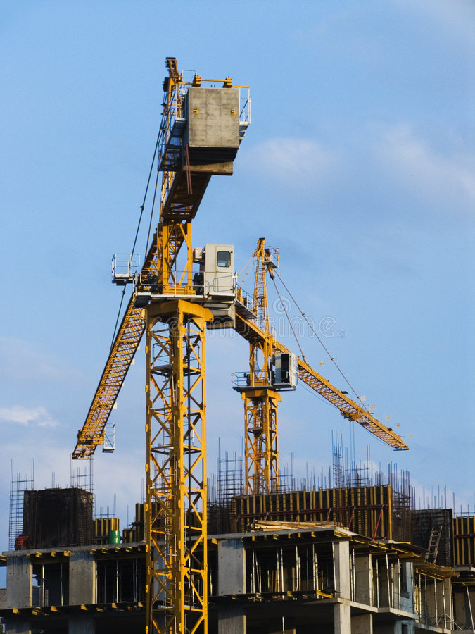 Two tower cranes royalty free stock photo