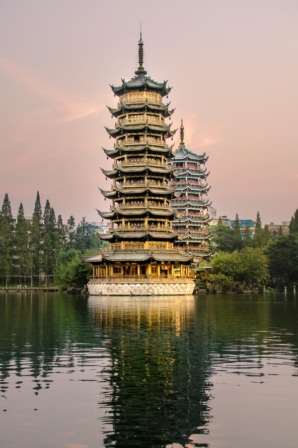 Download Two Towers In Guilin City, China At Sunset Stock Photo - Image of lake, place: 90254494