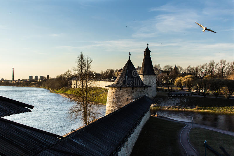 Two towers of a medieval fortress on the river bank. stock photography