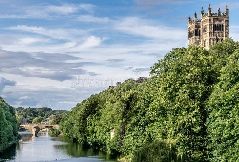 Two towers sticking up through a forest. Two towers, turrets protruding up through a forest next to a river. a stone bridge in the distance. a sunny summers day royalty free stock images