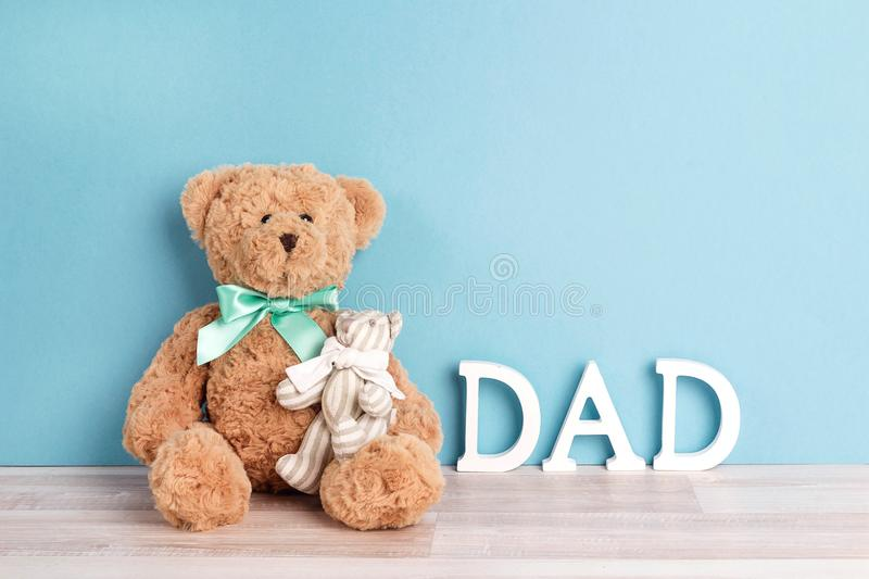 Two toy bears of dad and child on blue background. Father`s Day. Concept. Copy space royalty free stock photos