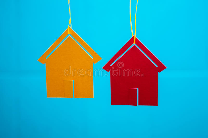 Two Toy Houses With Blue Blurred Background Stock Photos
