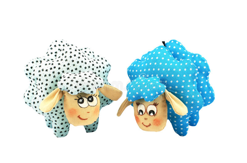 Two toy lambs, one blue speckled second turquoise speckled. On white background royalty free stock photos