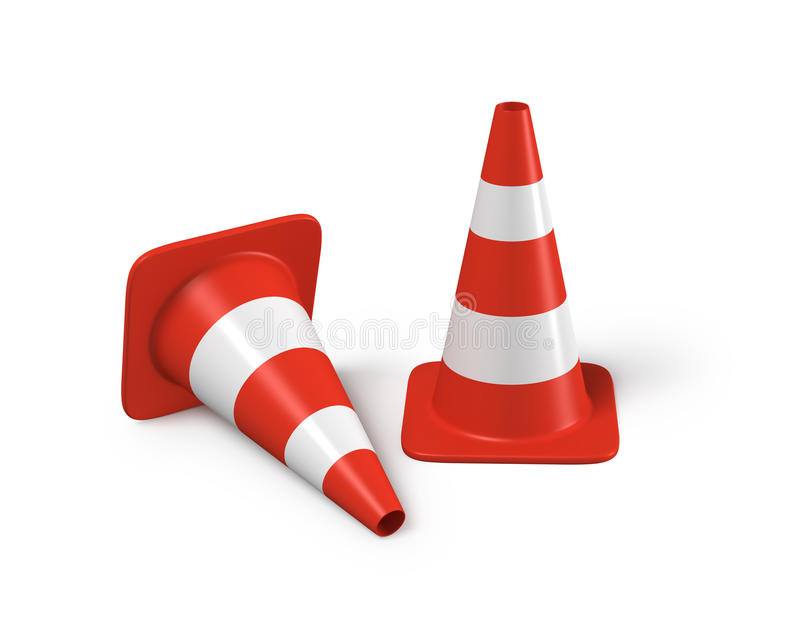 Two traffic cones with one lying down stock photos
