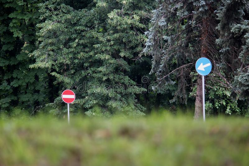 Two traffic signs in the forest royalty free stock photos