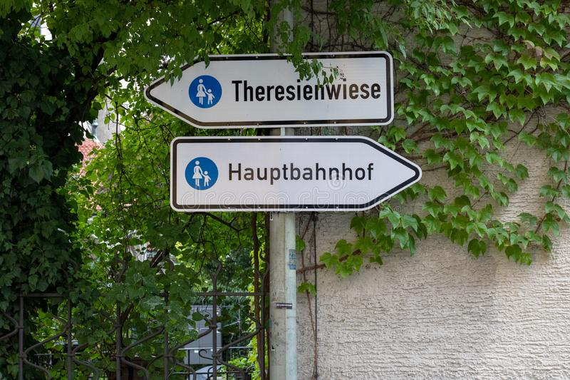 Two traffic signs `Theresienwiese` place of the octoberfest and `Hauptbahnhof` main station on the way between the main statio. N and the octoberfest in munich/ royalty free stock photography