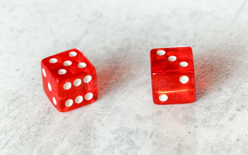 Two translucent red craps dices on white board showing Easy Eight number 5 and 3.  stock photography
