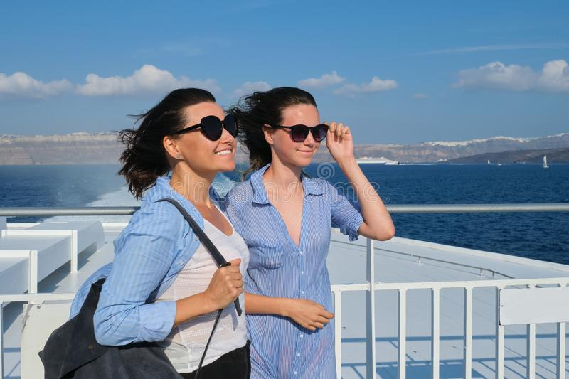 Two traveling women, mother and teenage daughter in luxury travel Mediterranean royalty free stock photography