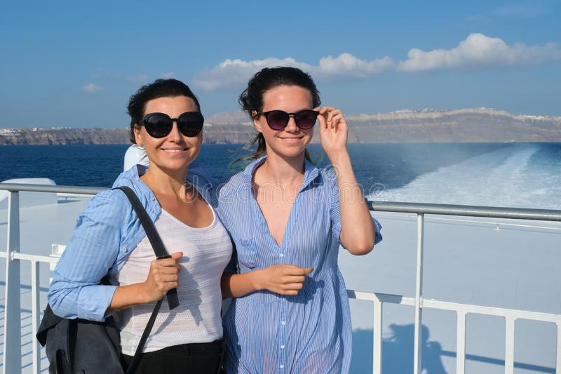 Two traveling women, mother and teenage daughter in luxury travel Mediterranean royalty free stock images