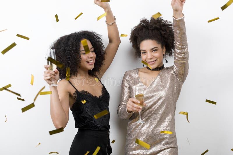 Two trendy women celebrating birthday stock photography