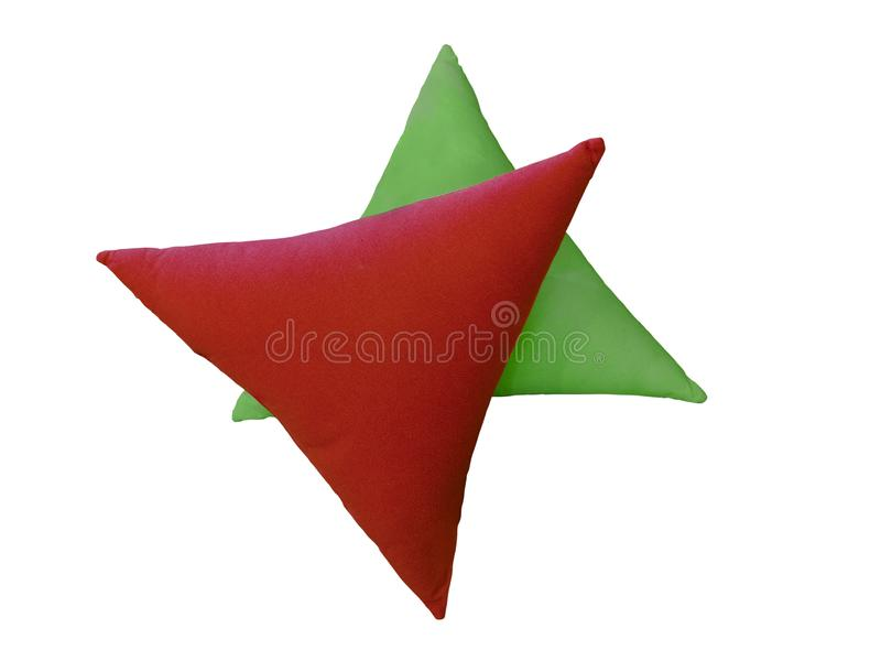 Two triangular decorative pillows. royalty free stock images