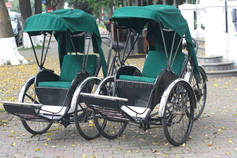 Two Trishaws in Hanoi, Vietnam stock images