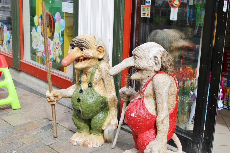Two trolls in Stavanger, Norway. STAVANGER, NORWAY - AUGUST 5, 2015: Two trolls in front of a store in the pedestrian zone of Stavanger. The trolls are famous royalty free stock photography