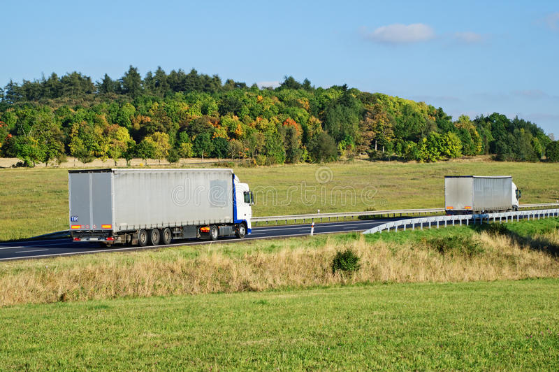 Two trucks on the road in the countryside stock photos