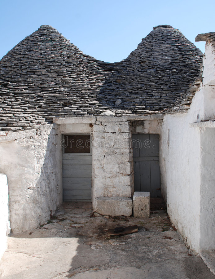 Two Trulli Doors. The doors of a trullo in Alberobello in Puglia, southern Italy. The trulli, which are protected under UNESCO World Heritage laws, are stock image