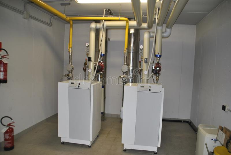 Twin boilers for heating. Two twin boilers for heating stock image