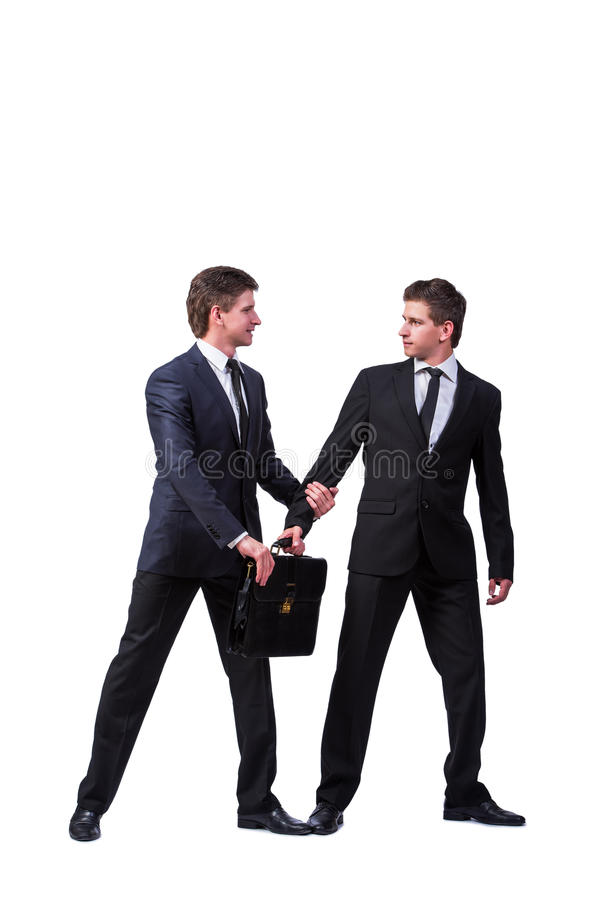The two twins businessmen arguing with each other isolated on white. Two twins businessmen arguing with each other isolated on white royalty free stock photography