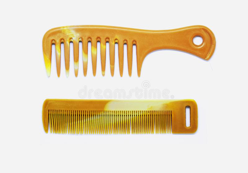 Two types of brown wood combs for hair styling or hair sets for both men and women with long hair, white background royalty free stock photos