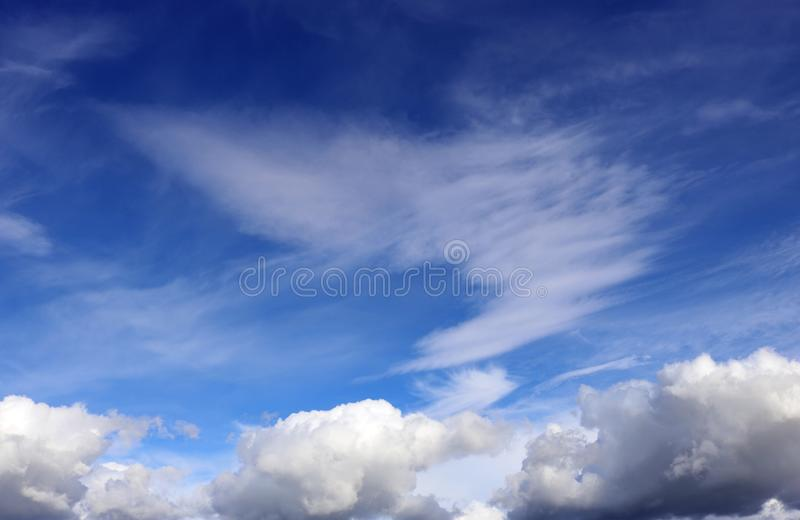 Two types of white cloud against a blue sky. royalty free stock photography