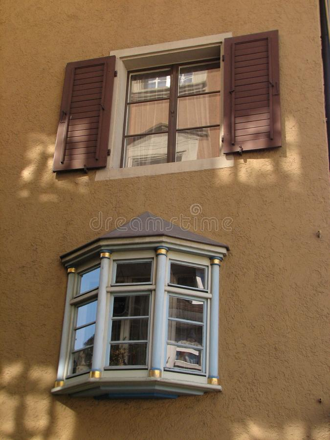 Two types of windows. Old building window. stock photography