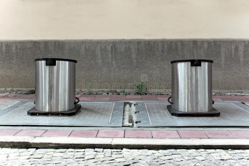 Two underground containers stock photography