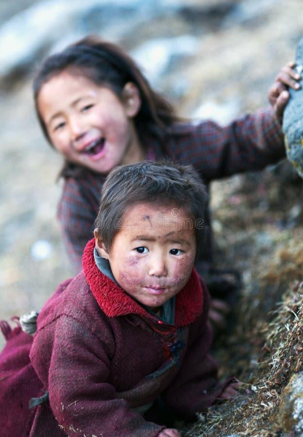 Two unidentified tibetan girls stock photography