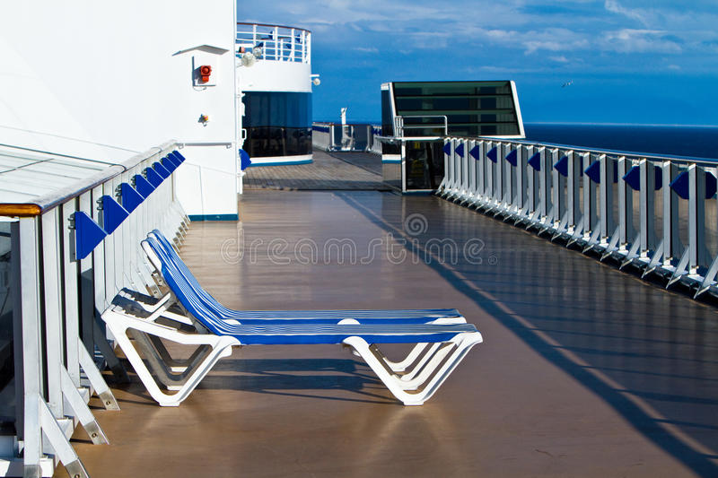 Two unoccupied lounge chairs royalty free stock photo