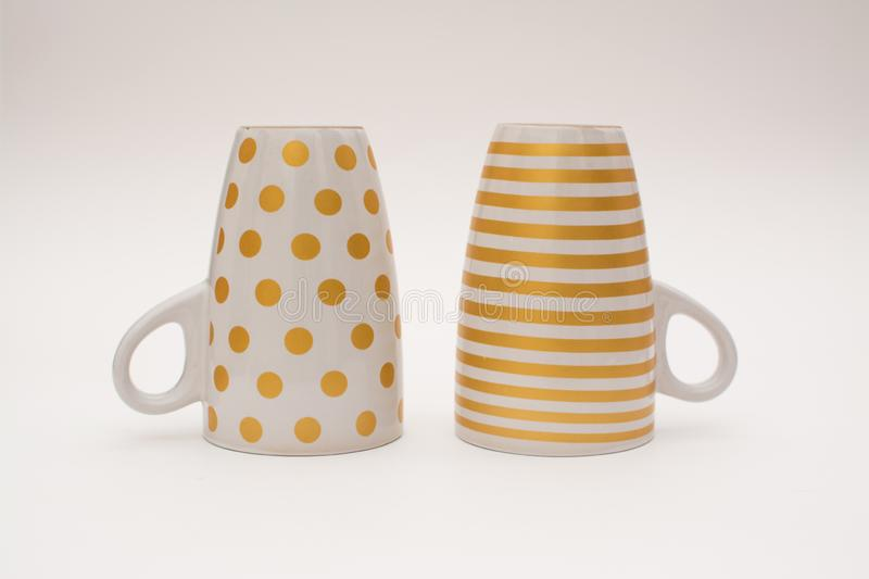 Two upturned cups of coffee. stock images