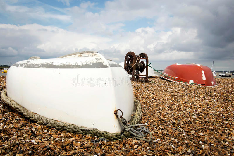 Two upturned row boats stock photos