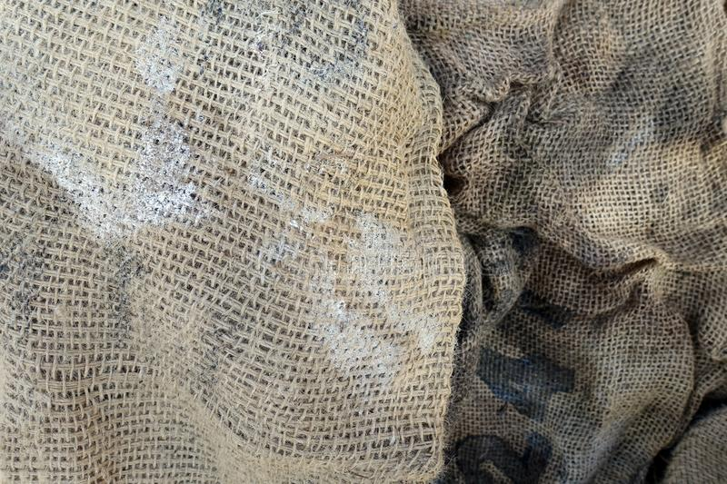 Crumpled Worn Burlap Bags Background. Two Used Crumpled Worn Burlap Bags stock photography