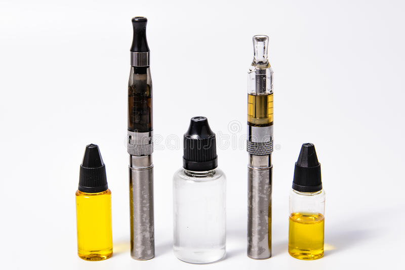 Two Vape E-Cig and Three vape juice bottles. Vape E-Cig and Accesories. All logo and text removed royalty free stock photos