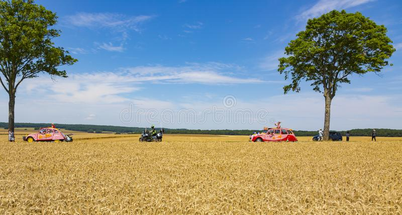Two Vehicles of Cochonou - Tour de France 2017 royalty free stock images