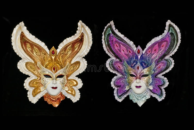 Two Venetian carnival masks isolated royalty free stock photos