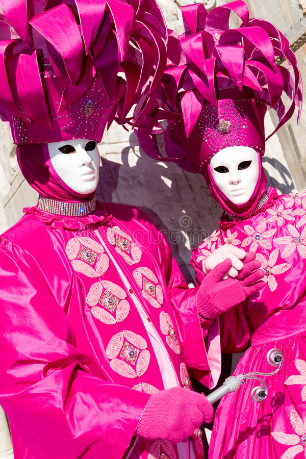 Two Venetians In Pink Costumes Royalty Free Stock Photos