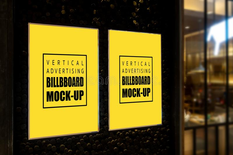 Vertical mock up billboard with frame placed on the wall stock photo