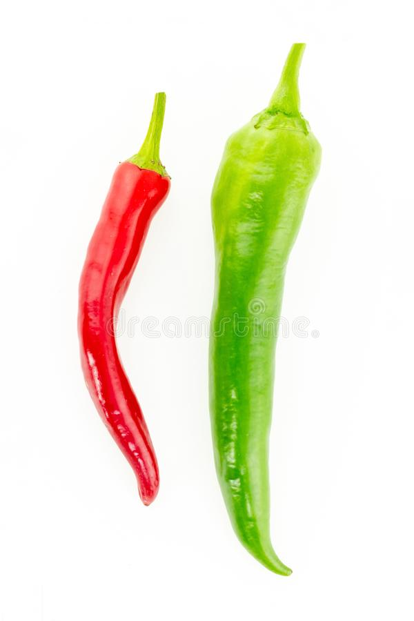 Two vertical pods of hot pepper red green vertical big small culinary background design stock photo
