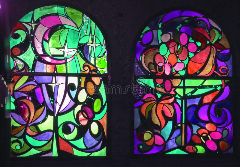 Stained glass geometric ornament clear purple green pink blue