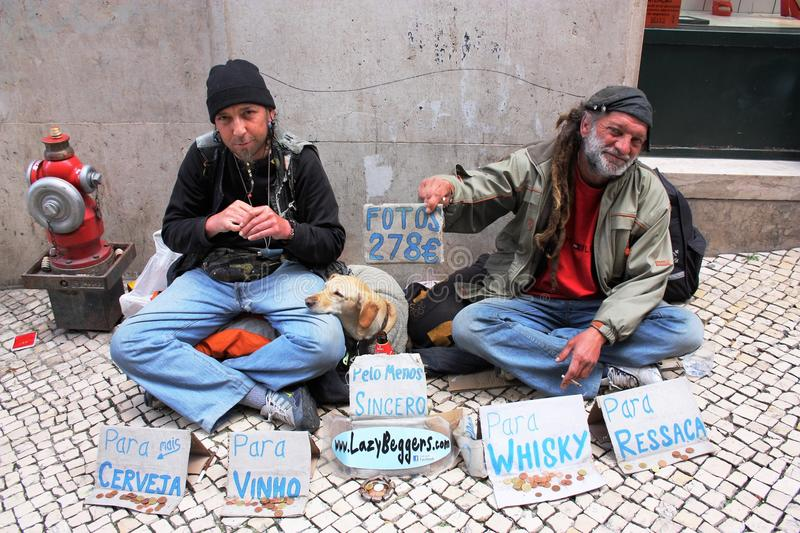 Lazy Beggers. Two very lazy beggars; in the traditional sense in that they live on the streets and ask people to give them money and also in the not-quite royalty free stock photo