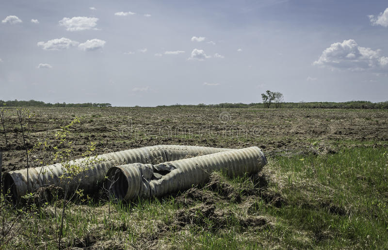 Two very old broken ditch drainage culverts royalty free stock photography