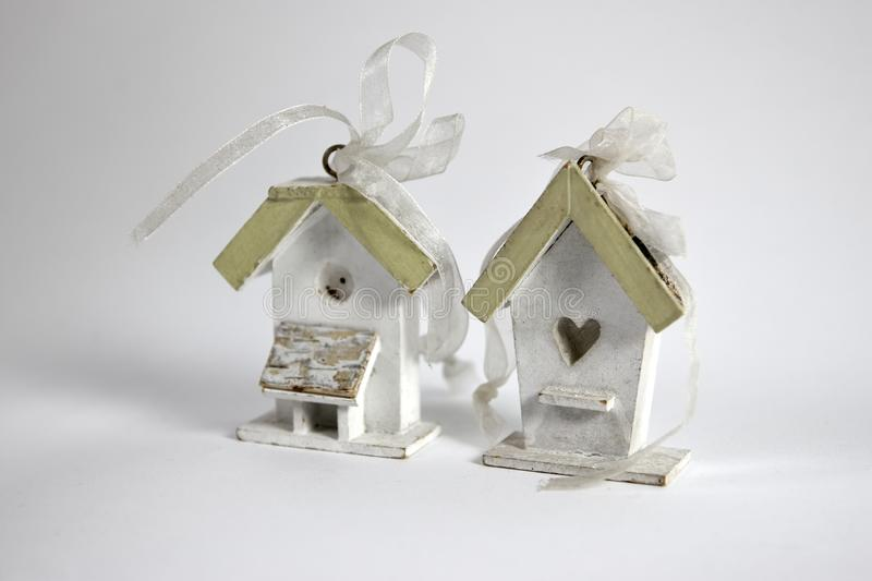 Two very small bird houses with a knot of ribbons on top stock photography