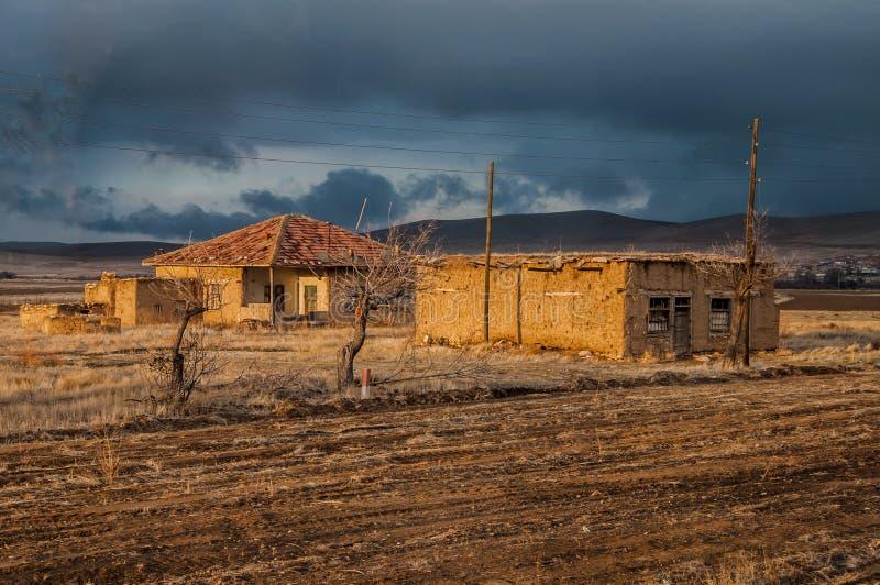 Two village houses at sunset, Konya, Turkey royalty free stock image