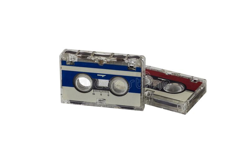 Two vintage blue and red small tape cassettes closeup isolated on a white background royalty free stock photos