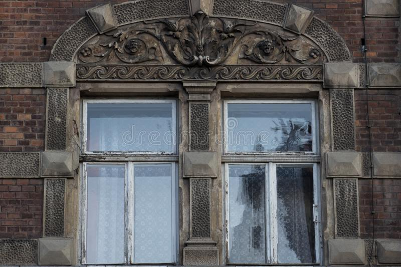 Two vintage front glass windows of an old house royalty free stock photography