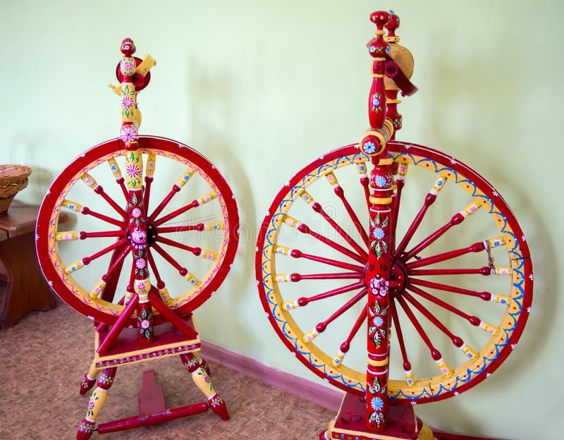 Two vintage nationally painted spinning wheels stock image