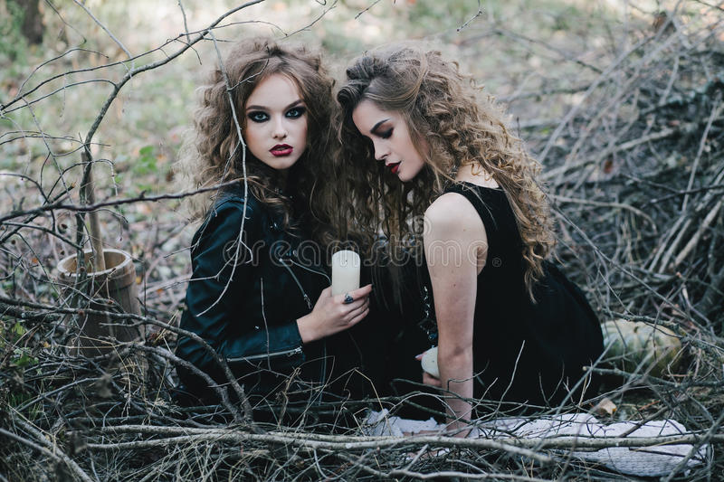 Two vintage witches gathered eve of Halloween stock photos