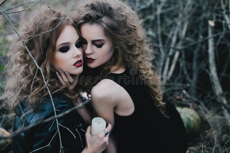 Two vintage witches gathered eve of Halloween royalty free stock images